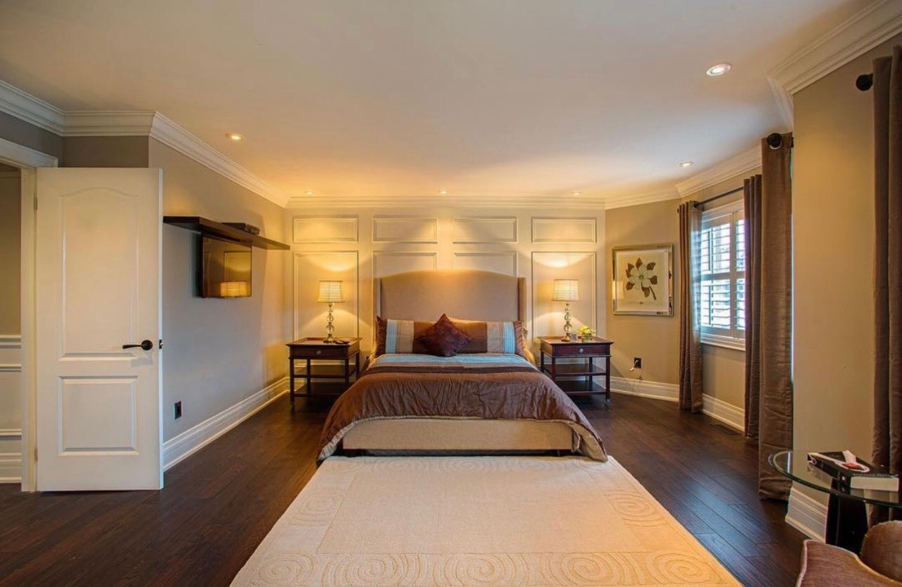 Wainscoting installed on a bedroom feature wall.